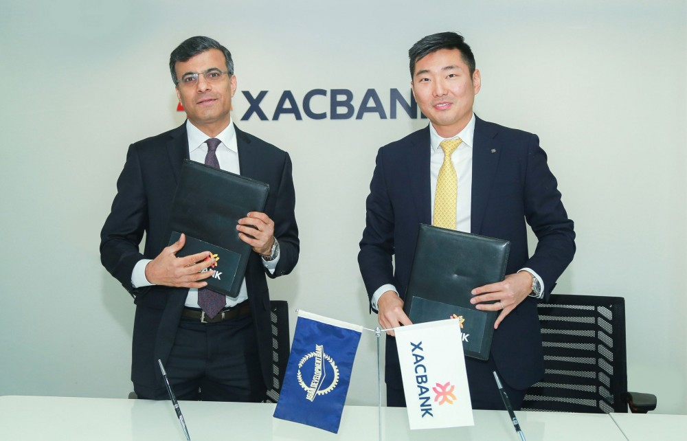 ADB Country Director for Mongolia Mr. Pavit Ramachandran (left) and XacBank Chief Executive Officer Mr. Tsevegjav Gumenjav during the signing of a private sector loan agreement on 16 December 2019 to support micro, small, and medium-sized enterprises in Mongolia.